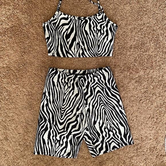Zebra crop top with matching shirts.